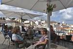 Inget besök i Lissabon är komplett utan en kaffe vid utsiktspunkten Porto do Sol.